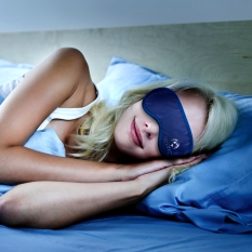 I added the sleep mask to this sleeping woman. Client was looking for images he could use of his products on Amazon